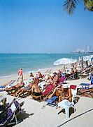 German tourists deepening their bronzed tans on Pattaya Beach.