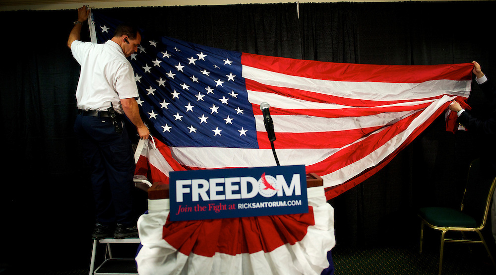Preparations are made hanging an American flag as the backdrop for Rick Santorum's stage before he announced he is dropping out of the presidential race during a press conference in Gettysburg, Pennsylvania April 10, 2012.