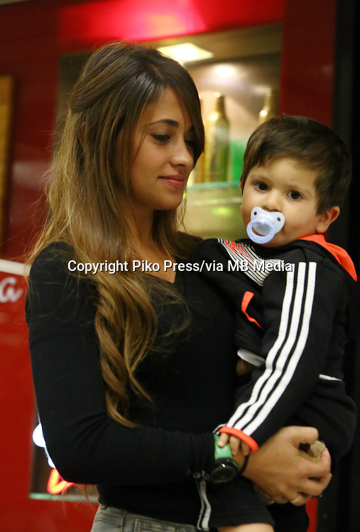 Fifa Soccer World Cup - Brazil 2014 - <br /> ARGENTINA TEAM -<br />  Lionel Messi wife ANTONELLA ROCCUZZO with their little son THIAGO at Confins Airport, taking and special Family charter back to Argentina, after see Yesterday match Vs Iran and enjoy Today Family day with LIONEL MESSI and others parents at the Argentine training camp in Cidade do Galo - Belo Horizonte - Brazil (BRA) - 22 Jun 2014 <br /> &copy; PikoPress