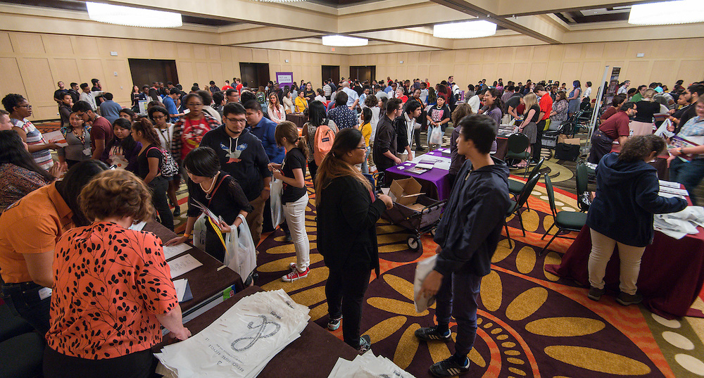 Houston ISD students talk with recruiters during Texas College Night at the University of Houston, October 28, 2015.