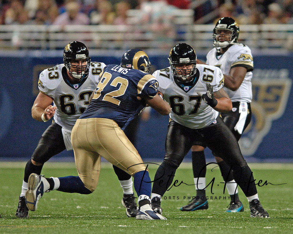 Jacksonville offensive linemen Brad Meester (63) and Vince Manuwai (67) block St. Louis Rams defensive tackle Damione Lewis (92), as Jaguars quarterback Byron Leftwich drops back to pass in the first half at the Edward Jones Dome in St. Louis, Missouri, October 30, 2005.  The Rams beat the Jaguars 24-21.