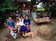 The Kuenkaew Family, 5:30 pm, May 31 1993, in front of their home with all of their possessions, Ban Muang Wa, Thailand. Published in Material World, pages 80-81.