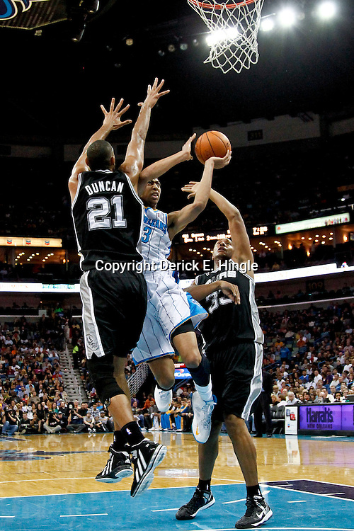 October 31, 2012; New Orleans, LA, USA; New Orleans Hornets power forward Anthony Davis (23) shoots over San Antonio Spurs power forward Tim Duncan (21) and power forward Boris Diaw (33) during the first quarter of a game at the New Orleans Arena. Mandatory Credit: Derick E. Hingle-US PRESSWIRE
