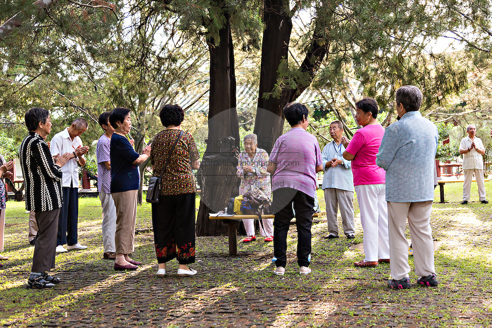 Elderly Chinese hold a prayer meeting early morning at the Temple of Heaven Park during summer in Beijing, China