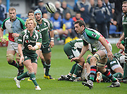 Reading, GREAT BRITAIN, Right, Peter RICHARDS, spins the ball out as Quins' George ROBSON move in to tackle, during the Guinness Premiership game, London Irish vs Harlequins, 19.04.2008 [Mandatory Credit Peter Spurrier/Intersport Images]