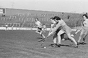 Cork and Wexford battle it out for possession of the slitor during the All Ireland Senior Camogie Final Cork v Wexford in Croke Park on the 21st September 1975. Wexford 4-3 Cork 1-2.