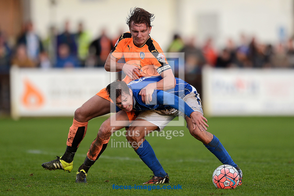 Alex Gilbey of Colchester United does battle with Matt Lowe of Wealdstone during the FA Cup match between Wealdstone FC and Colchester United at the Freebets.co.uk Stadium, Ruislip<br /> Picture by Richard Blaxall/Focus Images Ltd +44 7853 364624<br /> 07/11/2015