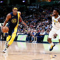 03 April 2018: Indiana Pacers center Myles Turner (33) drives past Denver Nuggets forward Paul Millsap (4) during the Denver Nuggets 107-104 victory over the Indiana Pacers, at the Pepsi Center, Denver, Colorado, USA.