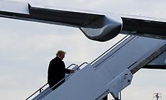 Trump boards his plane at Laguardia Airport