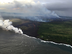 Handout photo taken on May 22, 2018 of Kilauea Volcano — Ocean Entry. The fissure complex, pictured in the upper right, continues to feed a meandering lava flow (in the center). Lava in the easternmost lobe is entering the ocean (white plume). Photo by usgs via ABACAPRESS.COM