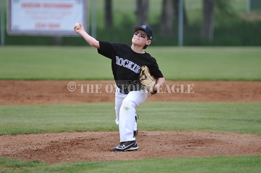 The Rockies' Bain Dunaway pitches in Oxford Park Commission baseball at FNC Park in Oxford, Miss. on Monday, April 16, 2012.