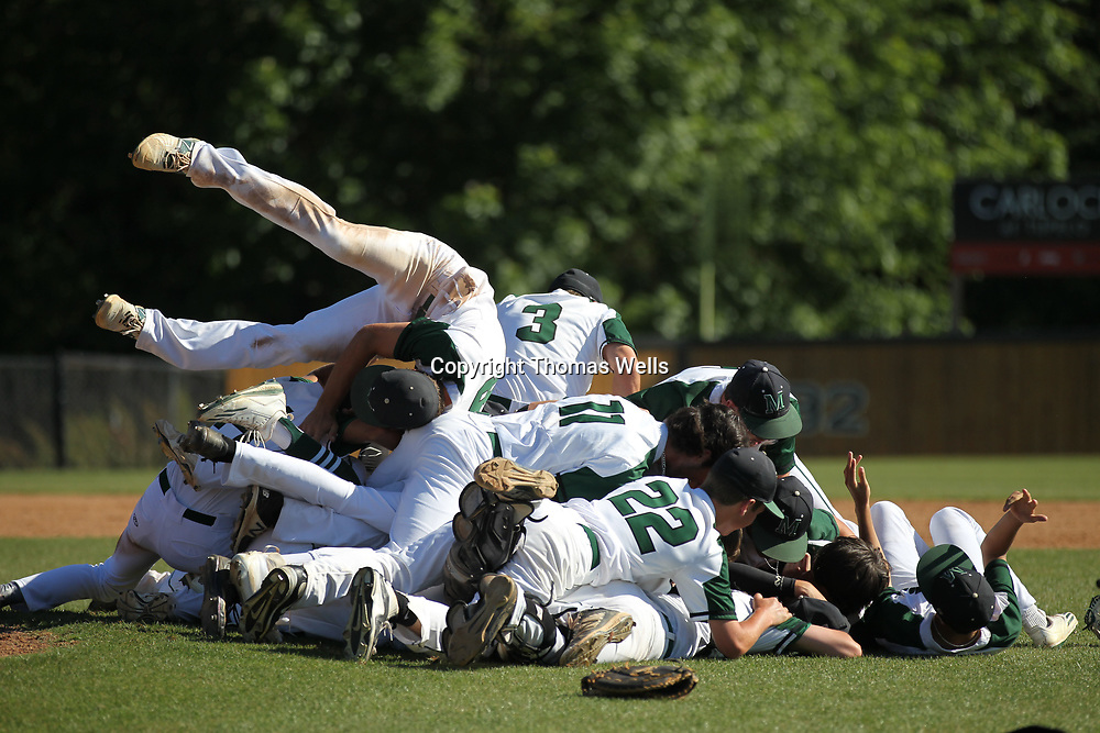 Mooreville palyers begin to celebrate after their 6-1 win over Kossuth on Saunday to advance them into next week's State Championship in Jackson.