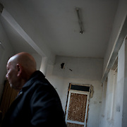 January 18, 2012 - Idleb, Syria: A local resident shows a room damaged by government troops shots and shelling during an attack to central Bennish. The man claims that the Syrian Army soldiers stole all his money, gold and other belongings during the raid to his house.