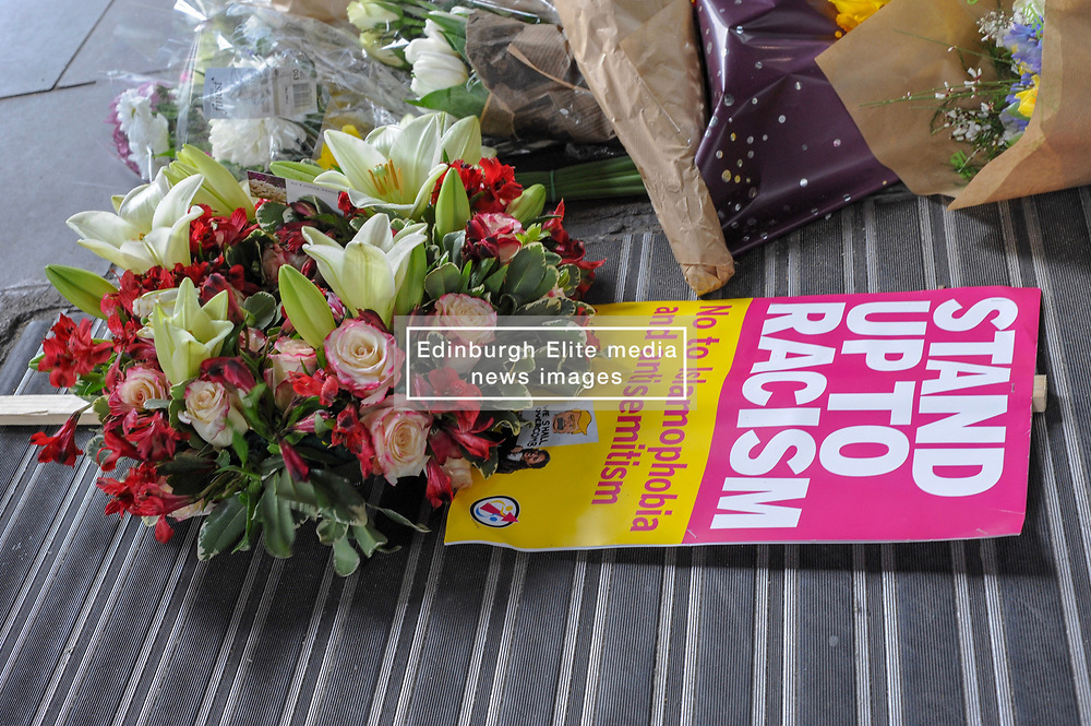 Demonstrators laid flowers outside New Zealand House during their march against racism. The march was organised by the campaign group Stand up to Racism. Westminster, London, 16th March 2019.