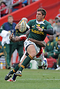 Ruan Pienaar of the Springboks is tackled by Ugo Monye of the Lions.<br /> Rugby - 090704 - Springboks vs British&Irish Lions - Coca-Cola Park - Johannesburg - South Africa. The Lions won 28-9 but lost the series 2-1 to the Springboks.<br /> Photographer : Anton de Villiers / SASPA