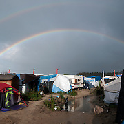 France, Calais. Last days of 'The Jungle'. Rainbow over tents.