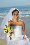 Happy Bride on Beach With Bouquet