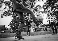 Ceará Machado plays football with his friends in front of the Copa do Povo (People's Cup) Camp in Itaquera, São Paulo. Even if the World Cup is the main reason to be without a roof he still loves the game and will suppport Brazil to lift the cup. The Copa do Povo Camp, is just a few miles from the Arena Corinthians and has 5,000 homeless workers and their families occupied area of ​​fifteen acres. They are homeless after rents skyrocketed because of the World Cup. (Eduardo Leal).
