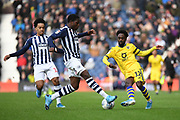 Swansea City midfielder Nathan Dyer (12) looks to release the ball  under pressure from West Bromwich Albion defender Nathan Ferguson (36) during the EFL Sky Bet Championship match between West Bromwich Albion and Swansea City at The Hawthorns, West Bromwich, England on 8 December 2019.