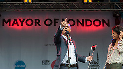 © Licensed to London News Pictures. 09/07/2016. London, UK. London's first Muslim Mayor of London, Sadiq Khan, and BBC TV presenter, Konnie Huq, on stage at the EID festival in Trafalgar Square. Photo credit : Stephen Chung/LNP