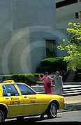 female,executives hail taxi,