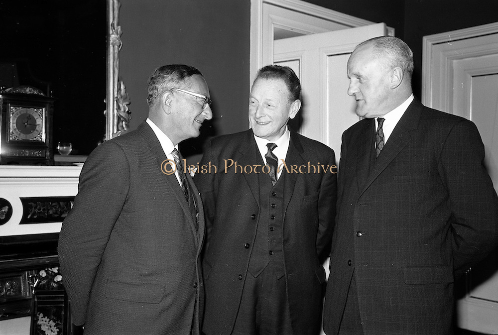 12/02/1963<br /> 02/12/1963<br /> 12 February 1963<br /> Launch reception for Irish Wool Weavers Co-operative Ltd. at the Shelbourne Hotel Dublin. (l-r): Mr. K. Ticher, Joint Sales Manager; Mr. J. Haughey, Chairman Coras Trachtala and Mr. F.E. Stringer, Managing Directer Hill and Sons Ltd..