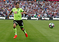 Football - 2016 / 2017 Premier League - West Ham United vs. AFC Bournemouth<br /> <br /> Bournemouth's Adam Smith races to kepp the ball in play at The London Stadium.<br /> <br /> COLORSPORT/DANIEL BEARHAM