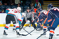 KELOWNA, CANADA - FEBRUARY 6: Linesman Kevin Crowell prepares to drop the puck between the Kelowna Rockets and the Kamloops Blazers on February 6, 2015 at Prospera Place in Kelowna, British Columbia, Canada.  (Photo by Marissa Baecker/Shoot the Breeze)  *** Local Caption *** Kevin Crowell;