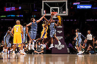06 November 2009: Guard Kobe Bryant of the Los Angeles Lakers lays the ball up in front of (4) Sam Young of the Memphis Grizzles during the first half of the Lakers 114-98 victory over the Grizzles at the STAPLES Center in Los Angeles, CA.