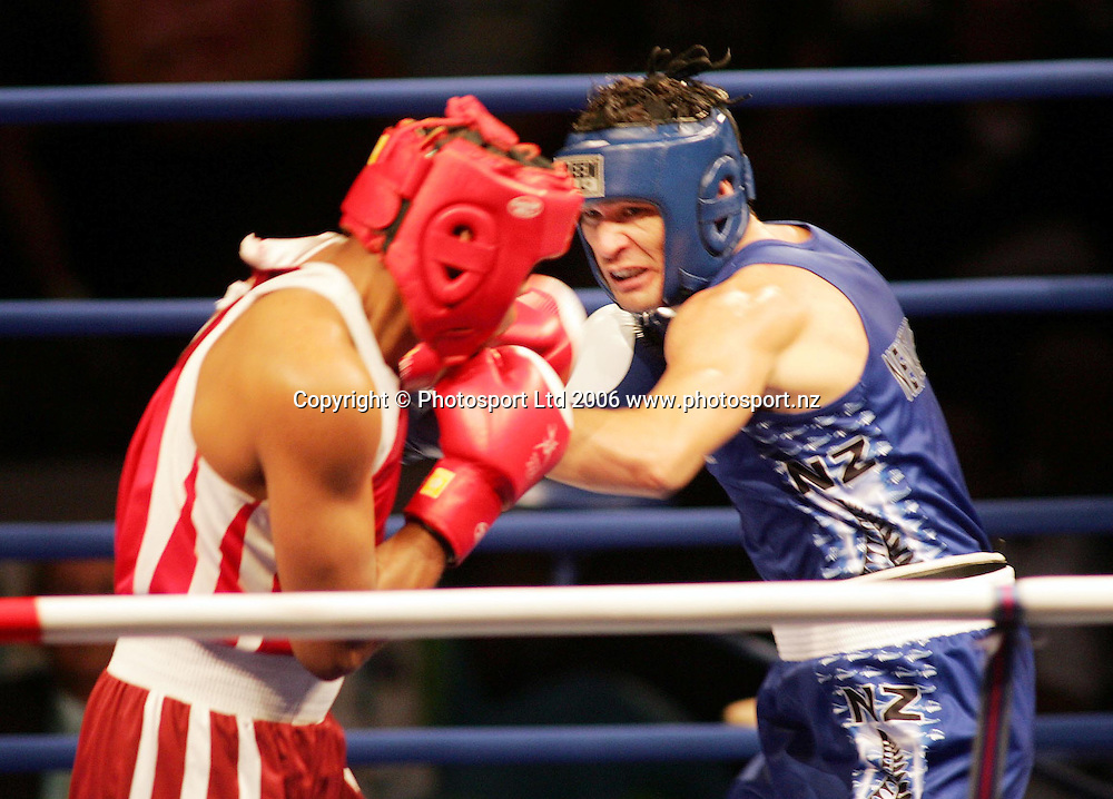 New Zealand's Kahukura Bentson (in blue) in action against Junior Greenidge from Barbados in the Middleweight 1/16 final at the XVIII Commonwealth Games, Melbourne, Australia, on Saturday 18 March, 2006. Photo: Joe Mann/PHOTOSPORT<br /> <br /> <br /> 150148