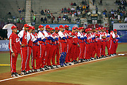 MEXICO CITY - MARCH 10: Team Manager (far left) Higinio Velez #39 of Cuba and members of the Cuba team watch pregame festivities at the Pool B, game four against Australia in the first round of the 2009 World Baseball Classic at Foro Sol Stadium in Mexico City, Mexico, Tuesday March 10, 2009. Cuba defeated Australia 5-4. (Photo by Paul Spinelli/WBCI/MLB Photos) *** Local Caption *** Higinio Velez