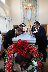 © Licensed to London News Pictures. 21/04/2018. Cobham, UK. Paddy <br /> Doherty (r) and his brothers stand at the coffin of their mother Queenie, Elizabeth Doherty at Sacred Heart Church in Cobham, Surrey. Elizabeth Doherty, whose son Paddy Doherty is known for appearing on My Big Fat Gypsy Wedding and winning Celebrity Big Brother 8, died of a heart attack earlier this month. Paddy Doherty claimed his mother has died of a 'broken heart' following the death of her husband almost a year ago. Photo credit: Peter Macdiarmid/LNP