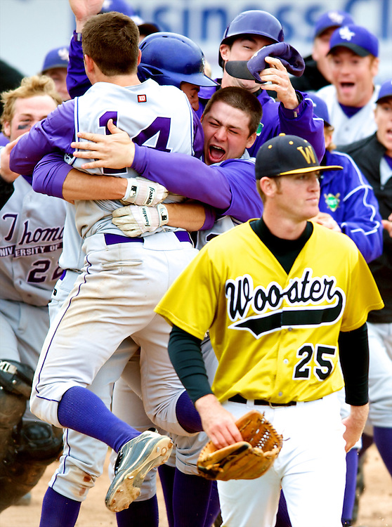 Wooster's Mark Miller leaves the diamond after the winning run scored for St. Thomas.