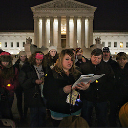 Lisa Johnston | lisajohnston@archstl.org | Twitter: @aeternusphoto<br /> <br /> Father Rickey Valleroy, pastor at St. Joseph in Farmington, MO, took his pilgrimage group to the steps of the Supreme Court of the United States on the eve of the March for Life to pray the rosary. They are just one of the many groups from the Archdiocese of St. Louis who have traveled to Washington, D.C. to participate in the March for Life.  Maggie Carr, the first grade teacher at St. Joseph parish school led the rosary for the group.