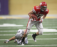 City High wide receiver Alex Evens (81) spins out of a tackle by Xavier corner Kyle Donnelly (30) in their Class 4A semifinal game at the UNI Dome in Cedar Falls on Friday November 13, 2009.