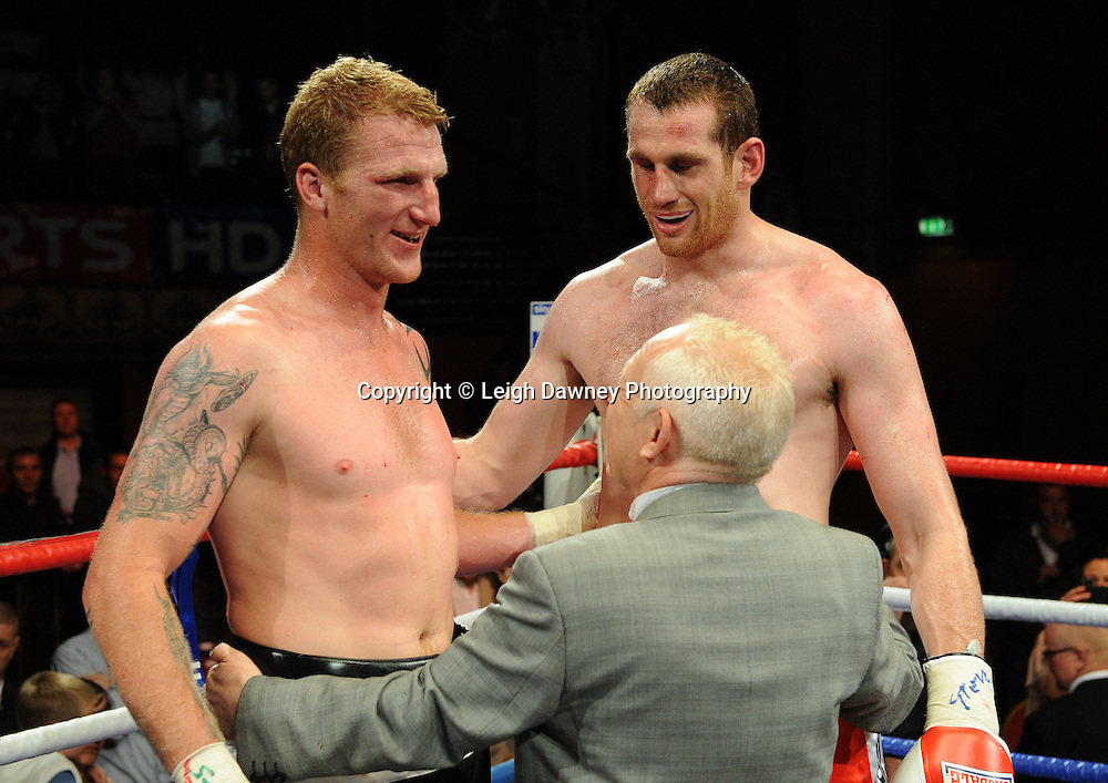 Promoter Frank Maloney congratulates both David Price and Tom Dallas for being good sports. David Price claims the British Heavyweight Title Eliminator contest at Olympia, Liverpool on the 11th June 2011. Frank Maloney Promotions.Photo credit: Leigh Dawney 2011