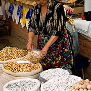 Woman selling nuts and traditional roasted apricot pits, Khiva