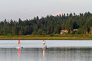 Two Paddleboarders on the Nicomekl River near Crescent Beach in Surrey, British Columbia, Canada.