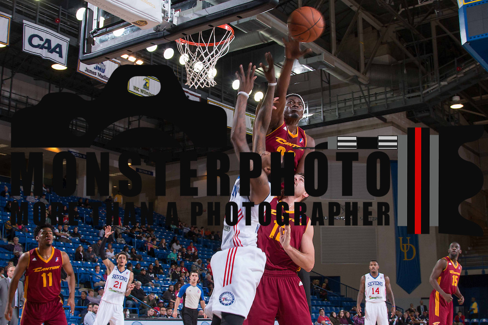 Canton Charge Center MICHAEL DUNIGAN (33) blocks a shot attempt by Delaware 87ers Guard JORDAN MCRAE (4) in the first half of a NBA D-league regular season basketball game between the Delaware 87ers (76ers) and the Canton Charge (Cleveland Cavaliers) Tuesday, Nov. 17, 2015, at The Bob Carpenter Sports Convocation Center in Newark, DEL