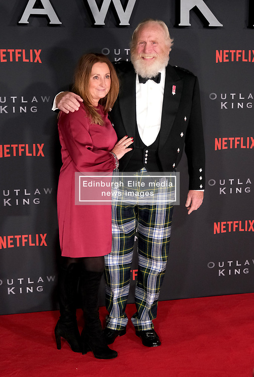 Outlaw King Premiere, Edinburgh, Friday 19th October 2018<br /> <br /> Outlaw King is a Netflix film and follows 14th century Scottish king Robert the Bruce prior to his coronation and through to his rebellion against the English, who at the time were occupying Scotland.<br /> <br /> Stars, crew and guests appear on the red carpet for the Scottish premiere.<br /> <br /> Pictured: James Cosmo and his wife<br /> <br /> Alex Todd | Edinburgh Elite media