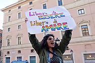 """Roma 23 Maggio 2015<br /> Veglia del movimento Sentinelle in piedi, in piazza San Silvestro,  in favore della famiglia """"tradizionale"""" e contro le Unioni Civili e i matrimoni gay, le persone che hanno partecipato alla veglia  sono rimaste in piedi in silenzio, per un'ora, leggendo un libro. Un gruppo  di attivisti Lgbt ha contestato la manifestazione.<br /> Rome May 23, 2015<br /> Vigil of the movement Sentinels standing in Piazza San Silvestro, in favor of """"traditional"""" family and against civil unions and gay marriage,  people who participated in the vigil were left standing in silence for an hour, reading a book. A group of LGBT activists challenged the event."""