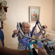 NURSING HOME<br /> <br /> Alice Jacobs, 90, is assisted into her wheelchair by Certified Nursing Assistants (CNA) Lisa Settle (right) and Treeousha Banks (left) at the Dogwood Village assisted living facility Friday, June 23, 2017, in Orange, VA.  Jacobs once owned a factory and horses, raised four children and buried two husbands.  But years in an assisted living facility drained her savings, and now, she relies on Medicaid to pay for her care.<br /> <br /> Photo by Khue Bui