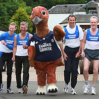 Members of the Strathearn Harriers with the Famous Grouse <br /> <br /> Picture by John Lindsay<br /> COPYRIGHT: Perthshire Picture Agency.<br /> Tel. 01738 623350 / 07775 852112.