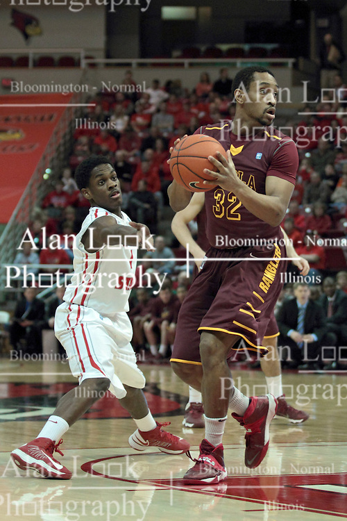 11 January 2014:  Paris Lee tries to dislodge the ball from Christian Thomas during an NCAA  mens basketball game between the Ramblers of Loyola University and the Illinois State Redbirds  in Redbird Arena, Normal IL.  Redbirds win 59-50