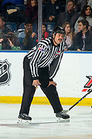 KELOWNA, BC - NOVEMBER 30:  Linesman Mike Roberts stands at the face-off circle during first period at the Kelowna Rockets against the Prince George Cougars at Prospera Place on November 30, 2019 in Kelowna, Canada. (Photo by Marissa Baecker/Shoot the Breeze)