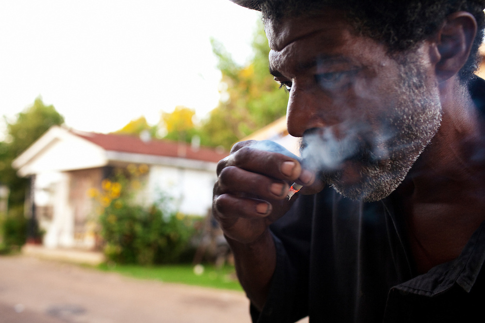 A older male smokes a cigarette in the Baptist Town neighborhood of Greenwood, Mississippi on Friday, July 2, 2010.