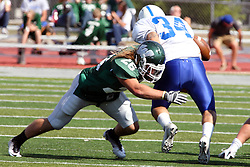 17 September 2011: the ball slips from the arm of Bobby Walsh as he is hit by Ryan Gresko during an NCAA Division 3 football game between the Aurora Spartans and the Illinois Wesleyan Titans on Wilder Field inside Tucci Stadium in.Bloomington Illinois.