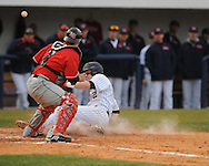 Ole Miss' Mike Snyder scores vs. Arkansas State catcher Kyle DeGrace at Oxford-University Stadium in Oxford, Miss. on Tuesday, February 23, 2010. Ole Miss won 3-2.