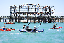 © Licensed to London News Pictures. Participants have a great time in the sea during Paddle round the pier 2015 beach festival taking place on Brighton beach, today June 5th 2015. Photo credit : Hugo Michiels/LNP