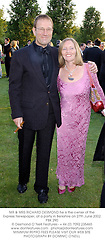 MR & MRS RICHARD DESMOND he is the owner of the Express Newspaper, at a party in Berkshire on 27th June 2002.	PBK 290